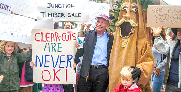 Representative Peter DeFazio good-naturedly poses with protesters of the O&C Trust Act.